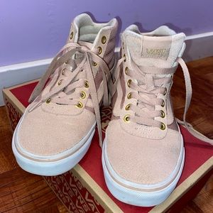 Suede pink high-top vans with gold accents